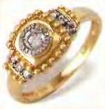 кольцо с крупными и мелкими алмазами
