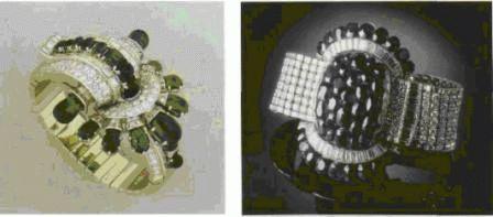 Запястье с изумрудами и бриллиантами с крупными завитками и мотивом веера. Дом Бушерон