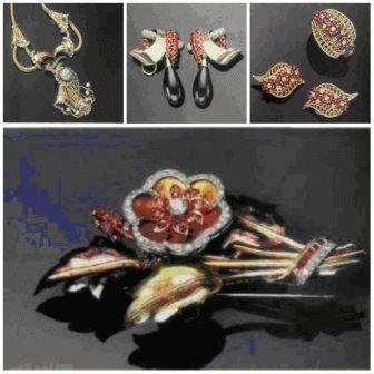 Клипса из золота двух цветов с рубинами и бриллиантами